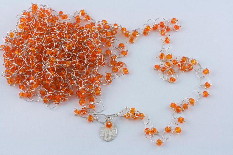 sita falkena ringetjes met oranje glaskraal
